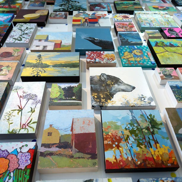 Small paintings on display.